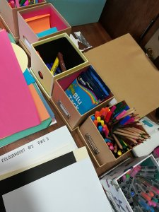 Boxes of paper, pens, blu-tack etc